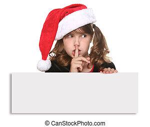 Un niño de Navidad aislado sosteniendo un cartel de blanco