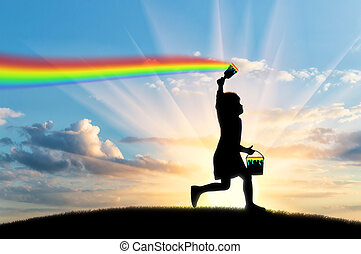 Un niño dibuja un arco iris en el cielo
