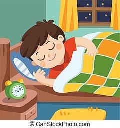 Un niño duerme en la noche.
