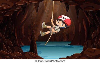 Un niño explorando la cueva del agua