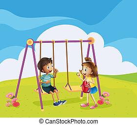 Un niño y una niña en el patio