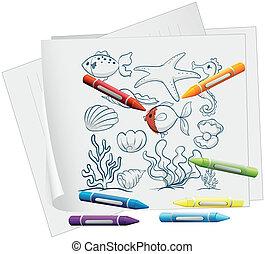 Un papel con diferentes criaturas marinas y crayones