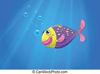 Un pez colorido bajo el mar