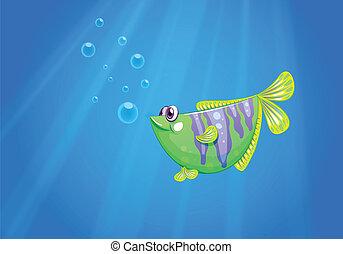 Un pez verde bajo el mar