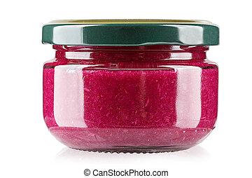 Un rábano rojo en un frasco