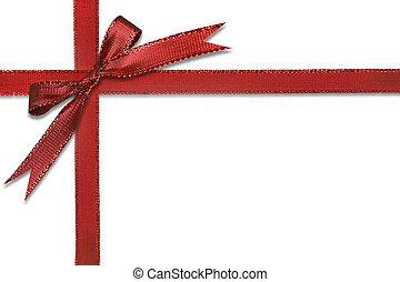 Un regalo de Navidad envuelto en un bonito arco rojo