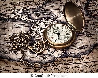 Un reloj de vinagre en un mapa antiguo