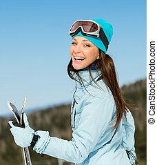 Un retrato de mujer esquiadora