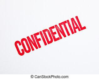 Un sello confidencial rojo en blanco