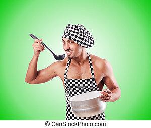 Un sexy cocinero masculino contra el gradiente
