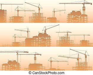 Un sitio de construcción con grúas.