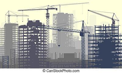 Un sitio de construcción con grúas