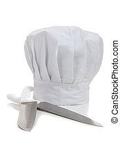 Un sombrero de chef con cuchillos de cocina