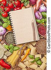 Un surtido de vegetales frescos y libros de recetas en blanco