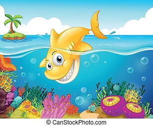 Un tiburón amarillo buceando en el mar