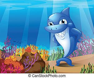 Un tiburón azul aterrador bajo el mar