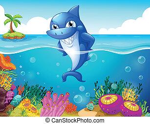 Un tiburón en el fondo del mar sonriendo