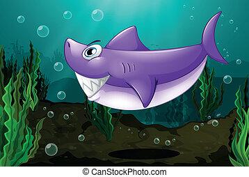 Un tiburón grande bajo el mar