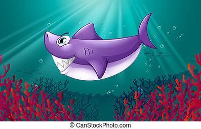 Un tiburón violeta sonriente bajo el mar