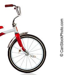 Un triciclo rojo en blanco