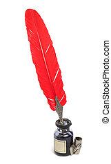 Un viejo conjunto de escritura con pluma roja
