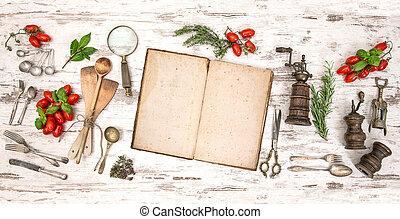 Un viejo libro de cocina con verduras, hierbas y utensilios de cocina antiguos