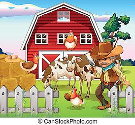 Un viejo vaquero armado en la granja con un establo rojo