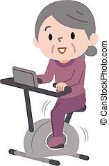 Una anciana haciendo ejercicio en bicicletas estacionarias en clase de gimnasia
