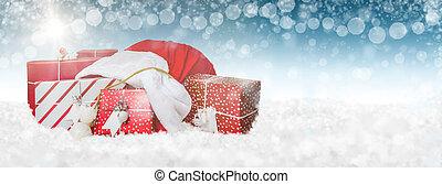 Una bolsa de regalo de Santa en la bandera de la web de nieve