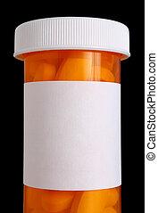 Una botella de medicina con pastillas