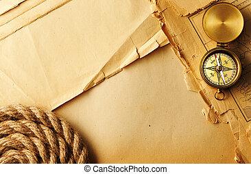 Una brújula antigua y una cuerda
