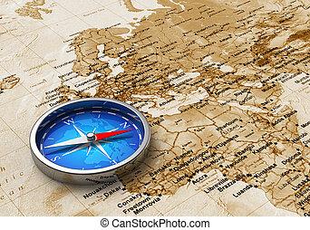 Una brújula azul en el mapa del mundo