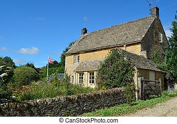 Una cabaña inglesa con jardín