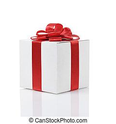 Una caja de regalos con moño de cinta roja hecho a mano