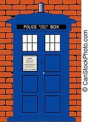 Una caja tradicional británica contra una pared de ladrillo rojo