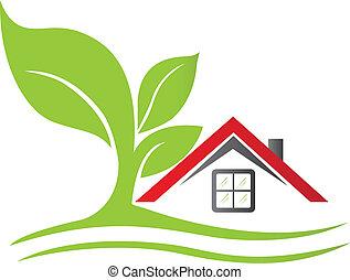 Una casa inmobiliaria con logo de árbol