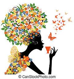 Una chica con flores con una taza caliente