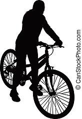 Una chica con su bicicleta