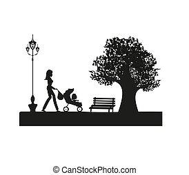 Una chica con un bebé en el parque