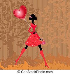 Una chica con un globo de San Valentín