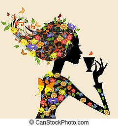 Una chica con un patrón de flores con una taza