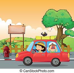 Una chica conduciendo y un chico tomando fotos