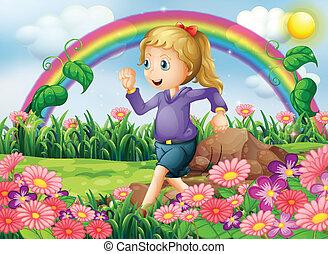 Una chica corriendo por el jardín