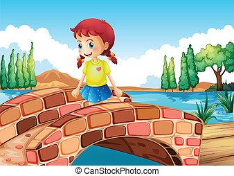 Una chica cruzando el puente