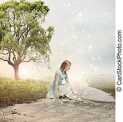 Una chica en un arroyo mágico