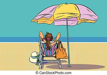 Una chica en un sillón en la playa