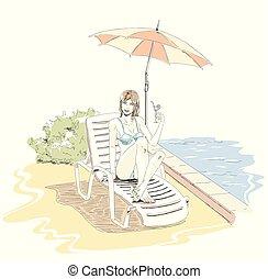 Una chica hermosa y elegante se relaja en el salón de la playa y bebe cóctel