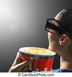 Una chica viendo cine 3D.