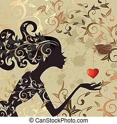 Una chica y un pájaro con una tarjeta de San Valentín