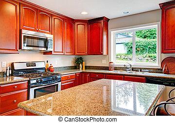 Una cocina brillante con combinación de almacenamiento de madera de cereza